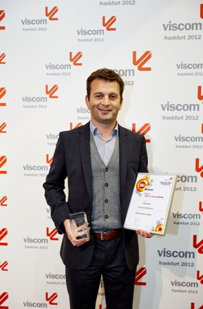 Mr Eli Keersmaekers CEO of Roland DG Benelux accepts the Viscom 'Best of 2012' award