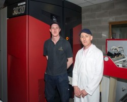 The new Xeikon 3030 machine with Stuart McCord, Xeikon Operator, left, and Keith Hamilton, Managing Director right