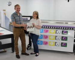 Ron Gardiner, lecturer at CAFRE, Loughry Campus, assists Food Technology student Linda Elder prepare sample packaging for an investigative project
