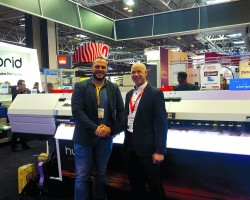 Andrew O'Brien of W.C. O'Brien and Bernard Hoey of Reprocentre with the Mimaki UJV55-320