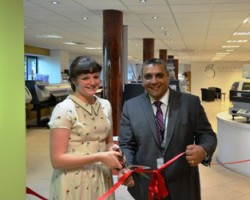 South Cheshire College Principal Jasbir Dhesi and student Megan Shepherd cut the ribbon on Hybrid's showroom